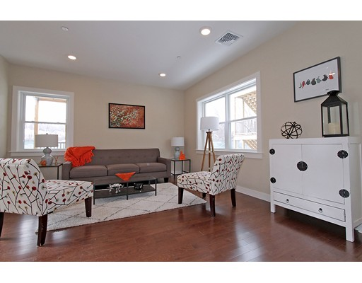 "JP's best New Construction value is now available! Introducing 99 Brookley: 3 gorgeous sun-splashed condominiums in a central JP location only minutes to the Green St ""T"" & Forest Hills!  STUNNING OPEN CONCEPT FLOOR PLANS OFFER 2 generous bedrooms for first floor units with 2 full baths including an en suite Master. Your wish list is complete with: Chef inspired kitchens with Shrock custom soft close cabinets, GE Cafe Appliances w/5 burner gas stove, stone peninsulas, glass tile backslashes, under counter lighting, high efficiency heating/cooling systems, Harvey windows, tall ceilings, recessed lighting, wood floors, great closet space, in-unit laundry hook ups & 1 car parking!! Each unit has an amazing almost 400sf of exclusive deck space with a master deck and a wrap around rear porch.  This JP location is perfectly situated in between both Forest Hills & Green Street T stations, as well as the SW Corridor bike-path, parks & green space, and nearby hip restaurants & shopping!!!"