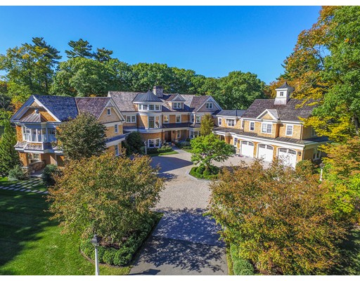 This Classic Shingle-Style Mansion, in Dedham's Precinct 1, provides a secluded 22+acre retreat with private pond within easy reach of Boston. Its foyer and spectacular three-story spiral staircase open on formal rooms, a library, a gallery, a guest suite and a stunning kitchen with a large fire-placed family room. Upstairs is a lovely master suite, a second laundry, five ensuite family bedrooms, a study area and a 2nd floor family room.  The ground floor has a wine cellar/ bar, billiards room, exercise room and a bath with steam and sauna, as well as a large theater and a large playroom. Outside you will find impressive landscaping and stone work with patios that overlook the pond, the infinity pool, the rolling lawns and the woods beyond. There is also a hockey rink with ice making and adjoining locker room, bathroom, garage and living room. 39+ acres of beautiful wooded terrain abut the property and are available for purchase as part of the estate.  Ask the broker for details