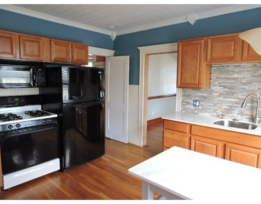 Spacious 2 Family Located in the Highly Sought After Parkway Area of Roslindale.  Both units have gleaming hardwood floors and open/dining living space.  Massive front porches have sweeping views from Sacred Heart Church to the Arboretum.  Kitchens have been renovated in the last 5 years with newer cabinets and solid stone surfaces.  Laundry is conveniently tucked away in the pantries for each unit.  Bedrooms are all generous sizes with ample closet space.  Unit 1 is a flat style with a grand foyer.  Unit 2 has the same lay-out on second floor with opportunity to finish 3rd level as a master suite or 2 additional bedrooms. The yard is perfect size for both entertaining and gardening.  It provides plenty of off street parking including a 2 car garage.