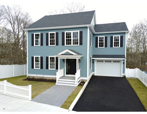 Gorgeous custom built New construction colonial home with garage parking!!  Wonderful front room with wainscoting (formal living or dining). Massive kitchen with huge center island outfitted with Shaker white cabinets, granite counters, five burner convection range, French door refrigerator and wine chiller. Plenty of room for bar seating and formal dining table.  Family room with gas fireplace and sliders to a large deck.  Enormous master suite with private bath with shower & double vanity and walk in closet. 2nd floor laundry, hall bath with custom tile work, walk up attic for storage or future potential, walk out basement with several full size windows, large level rear yard fenced in with garden area, garage that offer additional storage.  Truly a spacious home with a well designed floor plan with plenty of space to entertain and great everyday living.  This is a top Roslindale location only minutes to Roslindale Village, the Arboretum, the MBTA and commuter train to Boston!!!