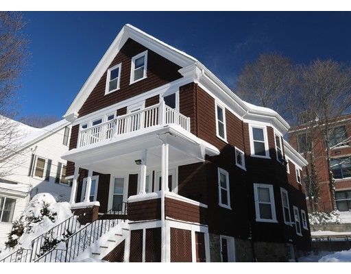 "Wonderful opportunity to own an oversized 13 room, two family home in one of the most desirable ""The Highlands"" neighborhood of West Roxbury. Steps to the commuter rail station or MBTA bus, local shops, library, delightful local restaurants, coffee shops, New YMCA & minutes to Millenium Park, Legacy Place, Chestnut Hill Shopping, highways & downtown Boston! This home offers hardwood floors, built in china cabinets, tiled bathrooms, pantries,  2010 roof,  2015 hot water heaters,  Burnham gas heating systems, Nest thermostats,  replacement windows, Full Deleading Compliance, & front and rear porches. First floor unit provides one floor living of 5 rooms while the 2nd floor unit presents an 8 room bi-level along with front & rear staircases, ideal for owner occupancy.  The 3 tier rear fenced yard is complimented by mature plantings, a spacious flagstone patio and 2 car parking driveway.  Home is being delivered in ""as is"" condition."