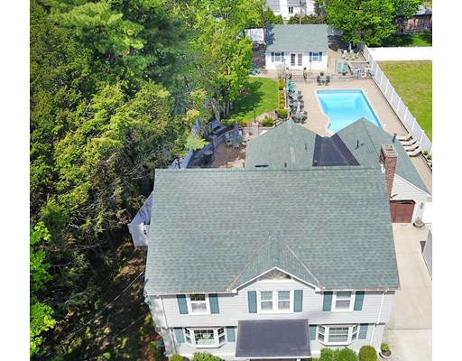 Boston's best total package! This rare urban oasis is an entertainer's delight with the warm feel of a home. Stately center entrance colonial on private cul de sac in coveted Highlands Area. Smooth layout on 1st floor encompasses fireplaced LR, sitting room (office currently), and formal dining all leading to a light and bright vaulted ceiling kitchen/family room combo wonderful for gathering. Professionally landscaped yard has it all and was designed for low maintenance- heated in ground salt water pool, hardscaping throughout with built in lighting, outdoor kitchen with fridge and wet bar, elevated grassy area for play, irrigation system, gas lanterns for some extra charm, and a 4 season guest house/cabana to top it off.  2nd floor has 4 ample beds. Expansion potential on 3rd level if desired, bring your ideas to customize to your taste and needs. Attached heated garage. Updated heat, A/C, windows, roof. Minutes to commuter rail, shopping and restaurants. Walk score of 78. A must see