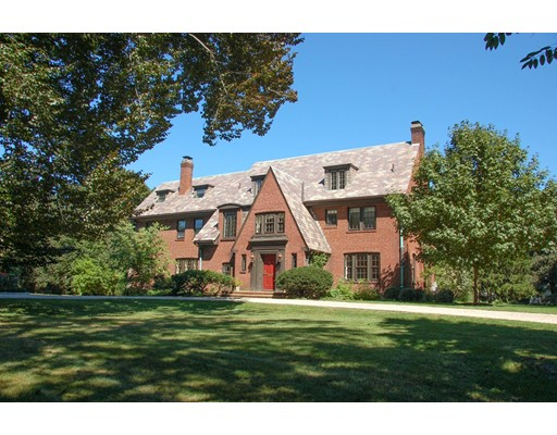 Gracious brick English Manor residence set on .63 acres in desirable Clark Hill, just minutes to Belmont Center. A wonderful blend of old world elegance and modern amenities, this 5,255 square foot southwest facing home offers 13  rooms, high ceilings, 2 fireplaces, and original butler's pantry. A grand foyer leads to a formal dining room and spacious living room with patio access. Gorgeous kitchen/family room features SubZero and Wolf appliances and custom cabinets. Second floor hosts 3 bedroom suites all with dedicated marble baths and an office. Third floor includes family room and fourth bedroom suite. Lower level is complete with office, recreation room, and wine cellar along with a  newer 2-car garage. There is also an expansive deck and stone patio. So close to the Center of Town, you can leave your car at home and enjoy the shops, restaurants, pool, library, Harvard Square bus and commuter train. 2008 National Association of Remodeling Industry Gold Award recipient.
