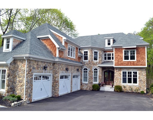 New Construction! Built by owners for their family. First floor has an open floor plan for entertaining in a family friendly setting, with eat-in gourmet kitchen, dining room, family room with fireplace, office/living room, large mudroom and guest suite with full bath. The large kitchen has a Wolf gas range with 4 burners, griddle and indoor grill, and an outside vented hood. Second floor features a spacious master suite with an octagonal sitting room and spa-like bath with three closets. Four additional family bedrooms are on the second floor, each with en suite or Jack-and-Jill baths, plus laundry. The lower level includes a recreation room, media room, playroom and exercise room, along with a full bath. Surround sound throughout the home. This convenient location is ideal for Cambridge and Boston and is a short distance to shops, restaurants and public transportation. It also abuts Audubon Conservation land, where gentle trails wind through forests, across meadows, and around ponds.