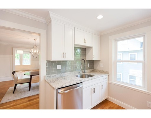 *** LOCATION LOCATION *** Come see this Gorgeous 8 room unit  light filled top floor. * 2 bedrooms New Bath with  Additional  Top Floor perfect for office or TV Room / kids play room. Loads of Closet space * So many Charming features in New Renovation * Super neighborhood of larger very Grand homes * Stunning Fireplaced living room with Handsome Crown Molding*  Sun filled windows in handy  Den/Office * Classic dining room with built in china Hutch * Sweet heated sun room overlooking lush level landscaped Yard * Garage parking plus 2 driveway spots *  Tons of natural light  - Everything New - New Windows * New Gas Heat and Central Air * New Roof * New Electric * New Kitchen and Baths * economical all Gas home * Near Arnold Arboretum, Millennium Park ( Dog Heaven) *** Pets Are welcome  , Longwood Medical , VA and Faulkner Hospital, Fenway Park !