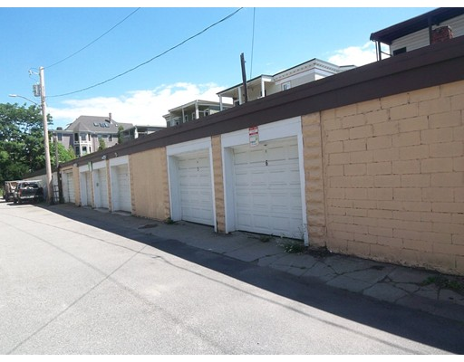 10 garage parking spots with automatic door openers and one extra storage space. Fully leased (slightly under market value). Market value of rents is $31,500, email for more details. Simple investment to manage.