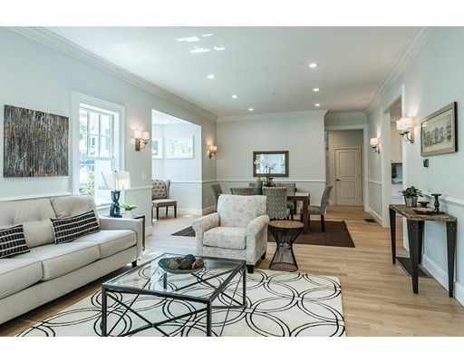 Spectacular, light-filled residence on a fabulous street in a highly desired neighborhood. Down-to-the-studs renovation and expanded, this perfectly designed home allows for grand entertaining spaces as well as comfortable family living. Gracious entry leads into the family room with soaring ceilings, beautiful crown moldings and pentagon shaped dining area. The well appointed custom kitchen has an oversized center island, lots of cabinet storage and a built-in desk area. The spacious laundry room is on this level.  The second floor features a luxurious master bedroom with spa-like bathroom. There is an en suite bedroom and two additional bedrooms on this floor with a Jack and Jill bath. There is an office on the 2nd floor also. The 3rd floor has a 5th bedroom and additional bathroom. There is a lovely yard with mature plantings. Convenient to shops, commuter rail, restaurants and easy access to 128.