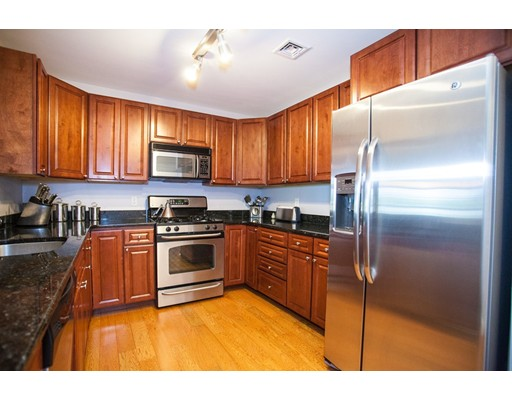 Expansive top-floor 2 bed / 2 bath West Roxbury condo boasting a spacious, open floor plan with engineered wood floors throughout. King sized master suite with large walk-in closet and master bath. This unit has 3 large closets with Elfa built-ins that can be configured to best suit your storage needs. In-unit super sized washer/dryer, large kitchen with cherry wood cabinetry, granite countertops and stainless steel appliances. The 2 full bathrooms both have marble floors and granite countertops as well. Just steps to the MBTA bus to Forest Hills T station and commuter rail stops. 5 min drive to Providence Highway and Legacy Place. This unit comes with 1 deeded garage parking space w/ additional parking on street or back parking lot for visitors. This pet friendly professionally managed condominium was brand new ground up construction in 2009.