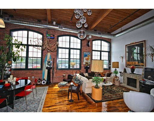 """This Simply Breathtaking Loft is located in the Former Westinghouse Factory Building that was painstakingly converted into 'The Lofts"""" in 2010. If you've been looking for Something Stunning, then Look No Further. This Mill Style Loft Building has Soaring 15' Ceilings with Exposed Brick and Beam Construction. There are 3 Massive Arched 10' Factory Windows that allow for Sunlight to Drench the Living Area and Accentuate the Recently Re-Finished Original Mill Style Hardwood Flooring. This Open Concept Style Loft also Provides a Gorgeous State-of-the-Art Kitchen, Complete with Stainless Appliances, Black Granite Counter Tops and a Custom Peninsula. In Addition... There's Laundry Inside the Unit, Central Air and a Bonus Office Area. Included in the Amenities are a Gym with a Cardio and Weight Area. The Main Entrance / Lobby also Doubles as an Artist Gallery Reception. The Commuter Rail is just steps away, and the Highway is just around the corner. OPEN HOUSE SATURDAY 6/24/17 FROM 12-2PM..."""