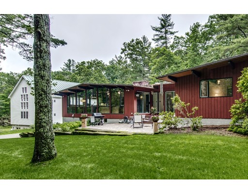 Post & beam contemporary home (4,100 sq ft) and barn/office/studio (5,000 sq ft) on private 4.9-acre compound. The home, a spacious custom midcentury modern, is a nature-lover's paradise; its soaring floor-to-ceiling windows welcome in the sunlight and make you feel at one with nature. With its communal spaces in one wing, living quarters in another, the open floor plan welcomes family gatherings and entertaining, while providing space and privacy for family members. Generous closet space, laundry room, fireplace, mudroom, and basement playroom are added attractions. But the most astounding aspect is the sparkling three-level barn constructed for their antique collection, library, home business and studio. Has half-bath, kitchenette, oversized 2-car garage. Possibilities for the barn: office, gallery space, studio, accessory apartment. Whether you're an artist, entrepreneur, writer or inventor, here is a place for your creative passions to blossom and for your family to thrive.