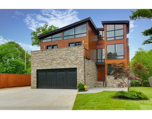 """WATERFRONT on Spy Pond.  Modern architecture design, this STUNNING property sits on 12,000+ sq. ft. of beautifully manicured private yard space with direct access to the water.  The deliberate and masterful construction, and quality of materials used to build this home are like-no-other ... exterior is Western Red Cedar, stone, concrete and copper; the interior is as meticulous and the views are breathtaking. Main level offers open concept living/dining/kitchen areas, wet bar, great pantry, study, half bath, 6ft. windows, 3 1/2"""" red oak hardwood flooring, high ceilings, and see-through fire place, all this space opens to a large Trex deck.  Level two has four bedrooms (including 2 en-suites, the master is spectacular) each with balconies and custom closets.   Level 3 boasts sun filled office area (or 5th bedroom) with walk out to roof deck and outdoor fire place.  The comfortable/cozy lower level has recreation/play area, media room and washroom. Welcome to your WOW home."""