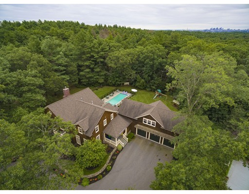 This grand estate is nestled into Winchester's most prestigious neighborhood, Ledgewood Estates, with beautifully wooded surroundings and rolling hills.This private compound has a large wooded backyard with a gunite pool, large outdoor mahogany deck and patio ideal for outdoor entertaining. Seldom does such a magnificent estate come on the market with such privacy and beauty. This estate lies 9 miles from downtown Boston or a short stroll to the commuter rail. This premier property has access to Fells reservation and is minutes away from the charming center of town and highly ranked schools.This exquisite residence features floor to ceiling French pella windows, ten foot ceilings, chunky crown moldings, 3 fireplaces, an enormous state of the art chef's kitchen, oversized island ideal for entertaining, large breakfast nook, custom white cabinets, stadium seating media room,3 car garage, screen porch.Custom designed with a sweeping open floor plan by award winning architect, Frank Olivia