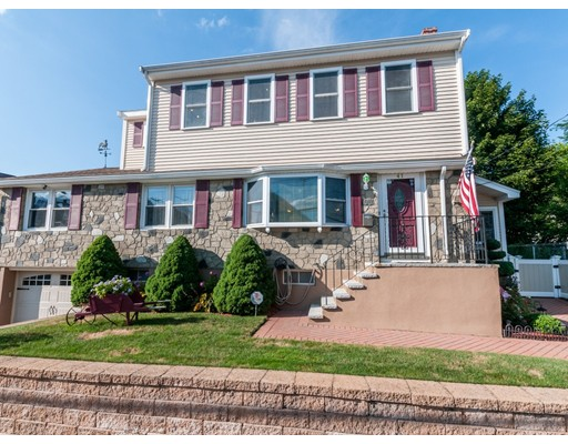 "Paradise found! Beautiful stone front colonial w/heavenly yard and state of the art UPDATES.Bright and spacious open-concept living/dining area,large box bay window streaming light!The kitchen/dining area has oversize granite island w/multiple seating. Triple window overlooking the flowering yard is surrounded by custom cabinets and expansive counter space,a chef's delight. 1st floor has 2 bedrooms & a modern & mint full bathroom plus a cozy sun room which exits both driveway and yard.The interior foyer leads to the crown jewel.An outstanding master bedroom suite enhanced by skylights, cathedral ceiling, fireplace w/sitting area, huge walk-in closet & full bath with jacuzzi!Ideal for bunk style bedroom for kids w/study area and tv room. .Finished lower level has den with 60"" TV, game room, pool table and 1/2 bath. Central A/C Central VAC. security system. supersize shed,.Sprinkler system front and back!  Minutes to commuter rail and bus to Forest Hills, blue Hills and bike trails!!"