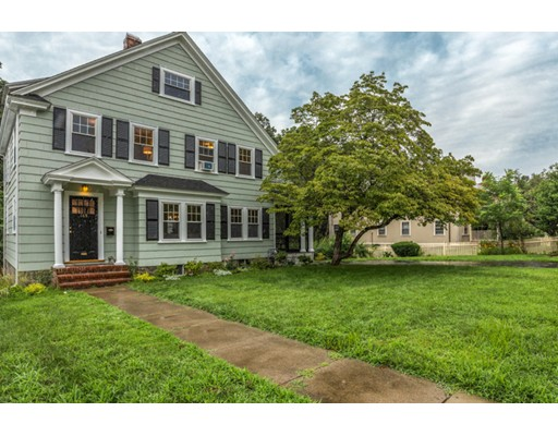 This tastefully renovated, single-family colonial home features endless detail and modern touches throughout. The sun-filled family room is highlighted by a gorgeous original fireplace that anchors the room. A three-season porch is located adjacent to the living room, offering a perfect place to unwind on warm summer evenings. The farmhouse-inspired kitchen has been beautifully transformed with black granite counters, chic glass tile backsplash and Whirlpool appliances; an attached deck offers access to the fully landscaped backyard. Four spacious bedrooms are located on the second floor, each with amazing light from their oversized windows. The third floor offers two large bonus rooms, endless storage and a full bath. West bustling commercial district along Centre Street offers residents an array of restaurants, shops and essential services. With easy access to highways and commuter rail, this is an ideal location for those looking for an urban lifestyle and the comfort of the suburbs