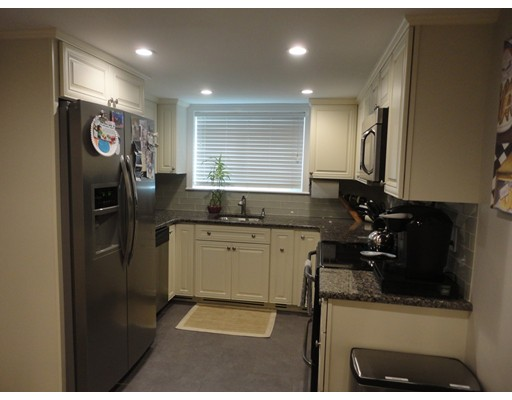 Much sought after Woodside Condominium complex in the Chestnut Hill section of West Roxbury. Owner upgrades include Newer  Kitchen with custom white cabinet's, Granite counters and Stainless steel appliances, finished with a large island, Built-in custom wall unit and solid hardwood floors in the living room,  Insulated walls and ceilings to make for quite living. Low condo fee includes heat and hot water. Convenient to downtown, Rt 9, 128/95 & Mass Pike, just minutes to Chestnut Hill shopping at The Street, Wegman's, Newton, Brookline, West Roxbury and Legacy Place!    Occupied by Tenants, 1st Showing Thursday. August 24th 5:00 PM-7:00 PM