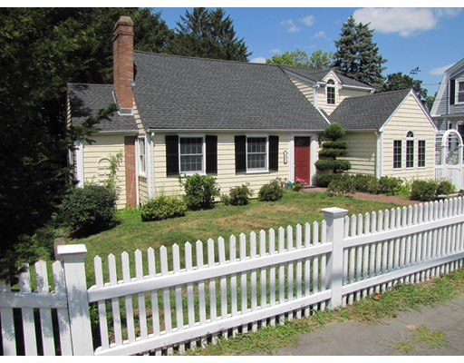 Classic 7-room Cape located in highly desirable neighborhood in Precinct 1.  Charming living room with fireplace and built-in bookshelves leads to sun porch with access to a small deck.  Eat-in kitchen with pantry and access to separate deck opens to a sunny and spacious family room.   The fourth bedroom and full bath completes the first level.  Previous owners used this bedroom as a dining room.  Second level has three bedroom and a full bath.   Basement is unfinished, spacious with laundry and a walk out to lower level deck and fenced back yard.   Walk to Historic Town Center with Vibrant shops, restaurants, coffee shops and restored Community Theater.     Minutes to Bus, two commuter rails, Legacy Place and Major Routes.