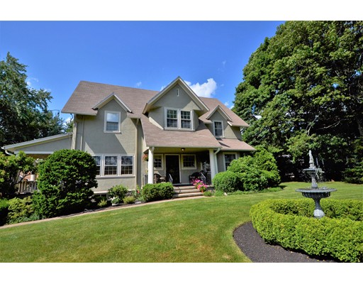 The rarest West Medford gem!  Luxury mini-estate in a private, more than 1/2 acre, park-like setting. Built in 1908 & lovingly restored, updated & maintained by the current owners for 20+ yrs, this one-of-a-kind home retains its original, unique woodwork & gracious period charm. Must-see features include a huge, working, fieldstone fireplace; exquisite wood-paneled dining room; spectacular butler's pantry; cozy window seats; over-sized side porch; enchanting outdoor fountain; 5 large bedrooms (one with a working fireplace), with generous closets; 3 updated full baths; granite & stainless kitchen with subway tile; new high-efficiency heat and hot water systems; outdoor sprinkler systems; gorgeous plantings; & a long list of recent updates. A restful retreat so close to Boston. Only a .6 mi walk to W Medford station -- be downtown in under 20 min. Medford Building Dept has informed owners the lot is subdividable, but buyers should do their own due diligence.