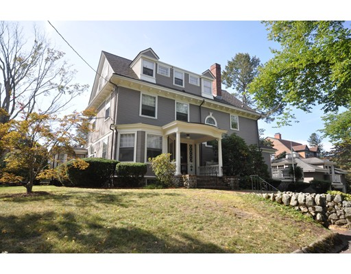 This spectacular Arlington Heights Colonial Revival is bursting with turn of the century charm and modern touches! The grand foyer, detailed woodwork, gleaming hardwood floors, arched doorways, high ceilings and stained glass windows are timeless. The classic family room has a fireplace and French doors that open to an amazing enclosed porch that is an absolute show stopper! The kitchen is open and bright with plenty of counter, cabinet & pantry space. There is a large dining room w/ fireplace & built-ins, tasteful office with skylight, & a gorgeous windowed living room. Each of the 6 beds and 4 baths has its own unique charm & details. The master will make you feel like royalty, w/ fireplace, sitting area w/ French doors that open to a balcony, and an enormous walk-in closet & stunning bath with soaking tub. The meticulously landscaped yard will transport you to an English garden, complete with secret stone passage ways! Don't miss the fabulous carriage house with an unfinished loft.