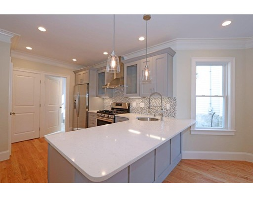 STUNNING NEW 2017 RENOVATION with all high-end designer finishes!! 61 Dent  offers 2 gorgeous sun-splashed condominiums  in a central West Roxbury  location. Unit #1 offers an open concept floor plan with 2 bedrooms & 2 full baths including an ensuite Master!  Exclusive use of 261sqft room in basement . Beautiful sunroom overlooking fenced in yard .This fabulous conversion  is complete with a Chef inspired kitchen with custom slate soft close cabinets, high-end Samsung Appliances, 5 burner gas stove, quartz counters, mosaic tile back splash, high efficiency heating/cooling systems tall ceilings, gas fireplace, recessed lighting, wood floors and in-unit washer & dryer  hook ups. Beautiful fenced in common yard space.  Nothing to do only move in !  Minutes to local shops, Restaurants, Parks and YMCA . Commuter rail  stop to downtown Boston is very close by