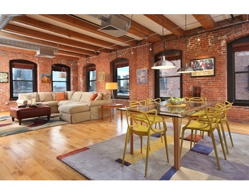 NEW PRICE!! Beautiful, bright 1690 square foot Loft on the North East corner of the building with amazing wrap around windows affording great views of Downtown Boston and the Seaport. Great Floor Plan with a huge Living and Dining Area that accommodates a large Dining Table. Open Poggenpohl Kitchen with large island, High - End appliances including Subzero refrigerator, Wine Fridge, Miele oven and Dacor Microwave. Huge Master Bedroom  and Study/2nd Bedroom. Gleaming hardwood floors and 11 foot ceilings with beautifully restored original wood beams. One full parking space (not tandem). On site management and maintenance. Strong building with great reserves and low condo fees. Located just steps to new, fantastic restaurants, shops and cafes. Walk to the Lawn on D, great retail options and much more in the Hottest Neighborhood in Boston! SELLER WILL PROVIDE A $25,000 CREDIT AT CLOSING TO BUYER TO GO TOWARD ADDING A 2ND BATHROOM. Open Houses Sat 12/2 11:30 -1 PM and Sun 12/3 12:30-2 PM.