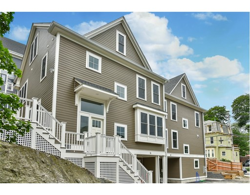 New Construction tucked away in one of the most desirable locations just blocks from the center of vibrant Jamaica Plain! This townhome is built with a modern lifestyle at heart and includes the amenities you crave. With its' own unique character this home has and open entertaining layout with an office and full bath on the first living level. Two additional levels of living space provide a total of four bedrooms, and three bathrooms as well as laundry, just where you want it, on the second floor! Designed to include master suites on the second AND third level, provides flexibility for smaller or larger families. The exterior spaces are wonderful as well.  Surrounded by foliage, an amazing back deck, lots of patio space & planting boxes are terraced into the surrounding puddingstone ledge. The exterior will provide years of maintenance free living and garage parking completes this urban dream home package.