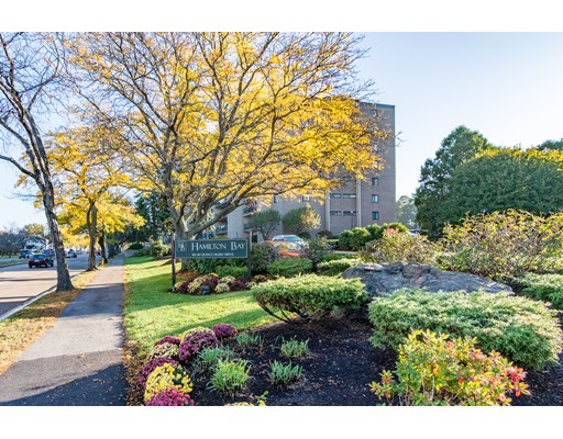 Hamilton Bay Condominiums, rear facing, spacious 2 BR, 2 full bath, 1,170' 8th floor condo boasts pergo flooring in living room and hallway, new carpeting in bedrooms, newly painted interior, updated bathrooms, newer kitchen with granite counters, elegant crown molding and baseboards, ceramic tile flooring and s/s appls, sliders from liv rm as well as 2nd br lead to a 25' private balcony with water views, laundry on each flr. condo fee inc heat, hw, w/s, central air...unit comes with one garage space and one exterior space, wonderful amenities include a tennis court, 60' heated I/G pool & clubhouse, located near N Quincy T & 6 mi south of downtown Boston.