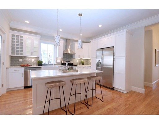 STUNNING NEW 2017 RENOVATION with all high-end designer finishes!! 14 Newburg Street offers 8 rooms, 4-5 bedrooms & 3 full baths all on 3 levels of living space in a central Roslindale location!  Wonderful floor plan with nice blend of traditional and open concept offering a fireplaced living room, large open kitchen/dining, first floor family room (or used as desirable main level bedroom with full bath!) A Pinterest inspired kitchen with  custom shaker soft close cabinets, farmstyle sink, high-end Samsung Appliances incl. 5 burner gas stove, quartz counters, designer glass tile back splash with a large island with bar area. High efficiency multi-zoned heating/cooling systems, tall ceilings with wrapped crown molding, pocket doors, recessed lighting, wood floors, and lots of character and detail work throughout. Updated throughout!! Short distance to Bellevue Commuter station and Roslindale Village. This is the perfect home!
