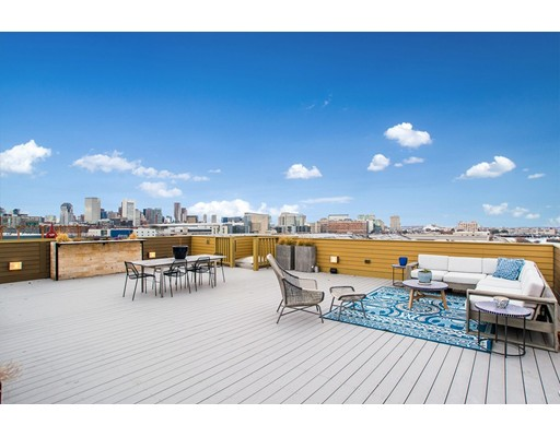 Flawless Penthouse! Almost 2900SF all on One Level! Jaw Dropping Views from Every Window! The Entire Boston Skyline! Direct Access to a Private 1000SF Roofdeck for Memorable Entertaining! 2 Heated Garage Spaces! Glorious Sunshine from 3 Exposures! Dramatic Open Side to Side Living Space with a Wall of Windows across the Front! 2 Balconies! 10 Ft ceilings! Striking Bleached White oak flooring throughout! Chef's Dream Kitchen features Viking appliances, 56 bottle wine fridge, Enormous island! Quartz countertops & Porcelanosa back splash tile to the Ceiling! 3 Extra large bedrooms with custom built out walk in closets! 2 are Ensuite! Media area can easily create a 4th bedroom! Lavish Spa Master bathroom with steam shower and double sink vanity! 4 zone Sonos audio system! 2 zones of heating and AC. Custom Hunter Douglas window shades! Deeded private storage. Professionally managed! A Truly Sophisticated & Outstanding Home!