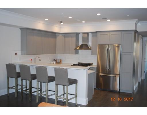 Condominio por un Venta en 12 ENTERPRISE STREET 12 ENTERPRISE STREET Boston, Massachusetts 02125 Estados Unidos