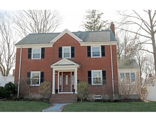 """SELLER IS ASKING FOR ANY OFFERS BY TUESDAY 4/4 AT 12:00PM. GORGEOUS Brick front Center Entrance Colonial located in the coveted """"Highlands"""" neighborhood! The foyer invites you into the front to back living room w/wood burning fireplace/mantle, separate sun splashed den/home office, formal dining room with wainscoting & two detailed built-in china cabinets. NEW 2016 white cabinet eat-in kitchen with subway tile backsplash, quartz counters & SS appliances! The second floor offers four well proportioned bedrooms and a modern tile bathroom. The fully finished basement makes a great family room and has a 1/2 bath, engineered wood flooring and a separate heating zone. Updated vinyl windows, 3 zone gas heating system, lawn irrigation system and a huge rear deck overlooking the level garden is perfect for outdoor entertaining! 2 car off street parking. Steps to Commuter Rail, Centre Street, delightful local restaurants, library, coffee shops, & minutes to Legacy Place or Chestnut Hill shopping"""