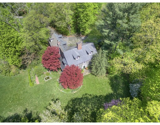 "This Georgian Colonial was built circa 1749 by a member of the Hammond family and later owned by John Lowell, a Judge in the U.S. District Court. The house has undergone many alterations over the years and for the past forty-plus years has been the beloved home of just one family.  The setting is bucolic with an oversized parcel of 1.36 acres of beautiful flat lawns, mature specimen trees and flowering gardens. This property offers the serenity of country living while public transportation, the shops and restaurants at ""The Street"" and ""Chestnut Hill Square"" The Longwood Cricket Club, Boston College and The Chestnut Hill School are all within walking distance.Walk Score is 71!  Beautiful original floors and moldings and wonderful natural light contribute to the character and charm of the property.  The house offers three plus bedrooms, two full and one half bath, six fireplaces and an attached two-car garage.  It's hard to believe this exists in Old Chestnut Hill."
