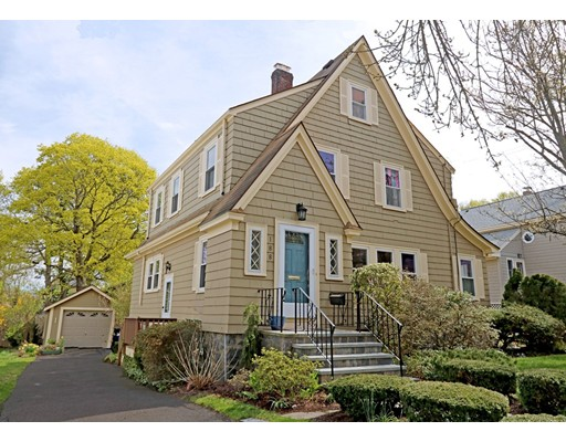 SELLER HAS ASKED FOR OFFERS TO BE SUBMITTED BY TUESDAY, 5/2 AT 12:00PM.  GORGEOUS wood shingle Colonial Tudor located on coveted Wren Street in the Belleuve Hill neighborhood! The foyer invites you into the fireplaced living room w/wainscoting & crown moldings, separate den/home office, formal dining room with wainscoting & built-in china cabinet & large eat-in kitchen with skylight! Stunning family room addition with wet bar, beverage cooler & granite counters overlooks the deck and lovely level yard is a gardener's paradise! The second floor offers three well proportioned bedrooms & two modern tile bathrooms including a stunning master suite with private bath/steam shower, dressing area and walk-in closets! Updated vinyl windows, newer gas heating system, oak wood floors and bonus walk-up attic has great storage!! One car garage + 4 car off street parking! Near Centre Street, delightful local restaurants, library, coffee shops, & minutes to Legacy Place or Downtown Boston!!