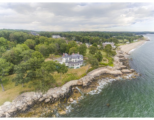 Amazing opportunity to own a piece of the North Shore's Gold Coast. This stately turn of the century summer home with a large wrap around porch and spacious rooms provides gracious living on an unparalleled piece of oceanfront land. Sweeping 200 degree views over Salem sound from Manchester to Marblehead with ample boating activity around the islands and harbors creates an endless and ever-changing seascape. Renovate the house for the old world charm or build a new state of the art home that suits your needs. Required 1 year demolition stay has been met. Create the estate of your dreams. On site swimming pool and tennis court need improvement. The level 2.6 acre lot is fully usable with a long circular driveway. A unique oceanside patio and terrace bring you to the waters edge. Part of the sought after Paine Ave Association in Prides Crossing, this elegant estate is direct oceanfront with beach rights. Also close to the commuter rail and downtown Beverly Farms.