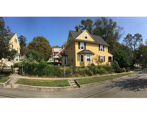Great investment opportunity! Could be three condos with city approval. House on #1 Irving St. sold last year for $1,515,000.00. Located in vibrant West Medford and steps away from bus and train station. Corner lot colonial receives light from east to west. One of a kind double fireplace warms both large kitchen and living room. French doors to formal dining room and front hall. Hardwood floors throughout except kitchen. Four beds, full bath on second floor. Third floor open loft space, previously three beds, with wood stove hook up, three-quarter bath. Recent bathroom updates-tiled ceiling, ceiling exhaust fan, electric wall heater. New gas furnace 2005. New roof 2007. Circuit breakers, gas hot water heater. Newer thermal pane windows on all three floors. Large fenced backyard has organic vegetable garden for many years.Orange Line bus to Sullivan Station,Green Line bus to Lechmere Station. One stop from North Station,Boston. Commuter rail train Lowell Line to Boston and points north.