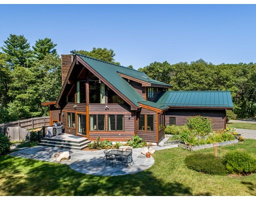 This custom built Cedar Post & Beam Contemporary is nestled on 20+ acres of privacy and natural beauty, including its own private skating pond. The open concept contemporary floor plan allows for large family gatherings whether it's in the great room which boasts cathedral beamed cedar ceilings and a two story wood burning stone fireplace or outside on the spacious bluestone patio. A wall of glass, two stories high, brings in ample sunshine while affording serene views of the surrounding private wooded setting. The main level has 2 sizable bedroom, a den and office. The second level has a spacious master suite, master bath, full walk in closet/dressing room, and a  small excercise room. Overlooking the main living area, adjacent to the master, is a loft room, a perfect addition to the master suite for a sitting area or secondary office. The lower level is finished and has exterior access to the side yard. There is an attached two car garage and lots of storage room.