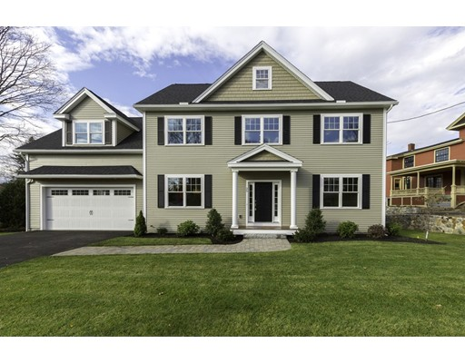 Awesome New Construction! Over 3400 sf ft of living space on 3 levels. Handsome CE Colonial with attached 2 car garage and professionally landscaped yard. Sun filled open floor plan - beautiful kitchen with white cabinets, SS appliances, granite counters, subway tile back splash. Center island with seating for three, and eating area with sliders to the deck & backyard. Fireplaced family room opens to living room. Formal dining room. The mud room has 2 closets, built in bench with cubbies and coat hooks. 4 bedrooms on the second level with a separate study area. Spectacular master suite with fireplace, separate sitting area, great walk in closet, two double closets, spa bath w/freestanding soaking tub, & oversized shower and double vanity. Main bath has a cast iron tub, double vanity & double linen closet. Second floor laundry room. Lower level has a sun filled walk-out rec room with full bath. Gas heating, cooking and 2 fireplaces. Hardwood floors on 1st & 2nd floors. Don't miss out!