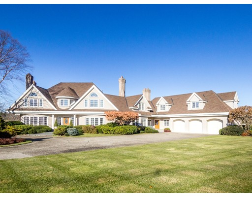 For the first time, this superbly built custom home has come to market! Perfectly sited on 6.4 acres surrounded by the fairways of the Dedham and Country Polo Club. Comprised of 11,000 feet of sophisticated living all finished with striking architectural design. Exterior stucco complete with 4 chimneys and 8 fireplaces. Grand entertaining spaces, all leading from an elegant, dramatic rotunda. Beautiful step-down living room, gracious dining room and private wood-paneled library. Large custom kitchen, adjoined family room, game room with wet bar and wine refrigerator.  Three season sun room overlooking lush professional gardens, terraces and private tennis court. Master bedroom suite and four other large bedrooms with adjoining private baths. Finished lower level with playroom, family room, and exercise room. 2017 state of the art Mitsubishi heat pump and air conditioning, newer roof, hot water tanks, windows, water systems, all located less than one mile to 128 and many private schools