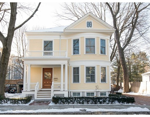 Renovated to the nines with top-quality materials and superb design, this elegant and light-filled turn-of-the-century Colonial Revival single-family residence is on a residential side street nearly next door to Harvard's Bunting Quadrangle, and close to Harvard Square. High ceilings, oversized windows, hardwood floors, excellent flow, and appealing period detail combine with a superbly appointed open plan eat-in kitchen/great room, to make for convenience, comfort, and beauty. There are bay windows, fireplaces, excellent multi-zone heating and cooling systems, and a generous number of bedrooms and baths, in addition to the spacious master suite. A separate side entrance opens into the bright lower level finished space, which offers high ceilings, good-size windows, an additional spacious bedroom, a full bath, a home office, and a large media or family recreation room, plus generous storage. A good-size yard and generous off-street parking add to this special offering's amenities.