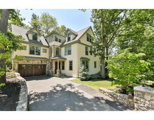 Chestnut Hill custom built & located on a quite hill top w/ stunning views. This Shingle & Stone style Neo-Victoria house has been meticulously designed w/ traditional details & modern comforts capturing dramatic tree top and mountains views. Featuring custom molding, mahogany floors and large picture windows with wonderful panoramic views. Highlights of the first floor include a living room w/ gas fireplace, dining room w/ coffered ceiling and skylight, custom kitchen w/ Subzero/Wolf appliances, Wood-Mode cabinetry, & granite counters with stacked edges & music room. The 2nd floor has 4 bedrooms including an exquisite master w/tray ceiling & two walk-in closets & tranquil Calacatta bathroom. There are 3 additional bedrooms: one en-suite, and two w/ a Jack & Jill bathroom all connected by a sitting area. The spacious 3rd floor rooms are all filled with natural light & include an elegant east-facing study w/ views of  Cambridge. Finished walk out lower level, granite patio. 2 car garage