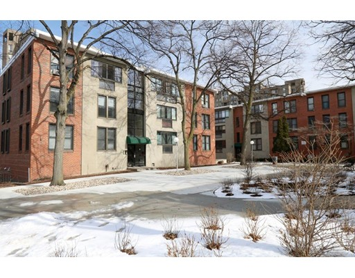 """OFFERS DUE & PRESENTED ON MONDAY 2/26 AT 12:00PM. A RARE FIND IN BROOKLINE AT THIS PRICE! This is the opportunity you have been waiting for!  Terrific Brookline Village location on a cul-de-sac near Brookline Ave & Longwood Medical Area!  This condo unit offers a living room which opens to a nicely enclosed porch, original kitchen, and 3 full bedrooms with a full modern bath!  Kitchen is dated but this unit offers tremendous upside to the new owner!  Ownership in Juniper Gardens condo complex includes a DEEDED PARKING SPACE and limited use of the adjacent Brook House pool!  Condo fee includes heat, hot water, maintenance & master insurance! Great association is 76% owner occupied & over $700k in reserves!! Close to Brookline Village, offering charming shops and great dining experiences and just a short walk to the """"Brookline Village"""" T stop, Jamaica Pond, Olmstead Park and the many renowned medical facilities just a short distance away at Longwood Medical. LOCATION, LOCATION, LOCATION!"""