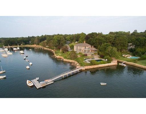 A rare opportunity to own a waterfront family compound consisting of 2± acres on Manchester Harbor with one of the few deep-water docks in Manchester-by-the Sea.   With 325± feet of water frontage, the property offers direct boating access to Manchester Bay and beyond.  Located on a peninsula on Smith's Point, the newly built, 5-bedroom English Arts and Crafts residence, and 2-bed guest house sit on one of the original Smith's Point's summer estate parcels.  Sited perfectly to take in the expansive harbor views, the home's design features harken back to its turn of the century predecessor featuring extraordinary interior finishes and classic elements with stunning views at nearly every turn.  The professionally landscaped grounds include a harbor facing pool and spa, a variety of mature specimen trees, flowering shrubs, perennial gardens and manicured lawns.  Includes access to private association beach and dock.