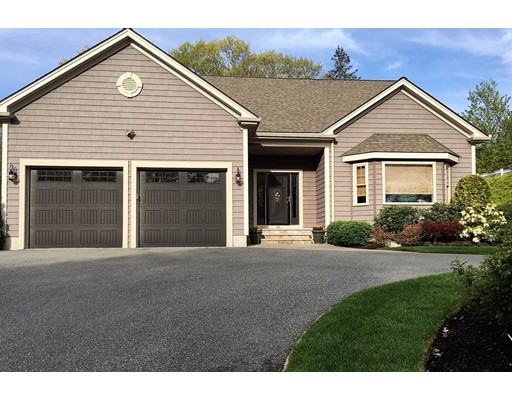 Meticulously maintained custom home offers an open concept kitchen/dining area w/walls of natural Cherry cabinets, large dining island, desk work-space, stainless appliances, granite counter tops & 8' slider - all South facing.  Custom Hunter Douglas blinds throughout.  First floor master suite has a  huge (11' x 9') walk in closet & lovely bath (2 bowl vanity, tiled walk-in shower w/bench seat, glass door, linen closet).  The hallways are nicely wide.  9' ceilings and crown moldings entire 1st fl. There is a line of rail fencing & trees & plantings.  Rear of the property is wooded.  Double wide drive parks 4 & there is also a curved drive for 3-4 - so plenty of guest parking. Covered entry, Bluestone treads on the stone front steps, pavered walkway, architectural stone walls & 20' x 20' patio. Surround sound in living room, Semi-finished (wired, vented for heat/air, insulated) space on the second floor to easily add a 4th bedroom & still retain storage space.  Basement is wide open.