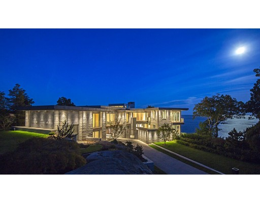 "Prepare to be amazed by Kragsyde, an astonishing private waterfront estate set atop a rocky outcropping on Boston's storied North Shore. Finished in 2015 and claiming the preeminent site in the exclusive Smith's Point neighborhood of Manchester-by-the-Sea, this modern stone and glass eyrie is a spectacular waterfront property that combines uncompromised ocean views with breathtaking modern architecture, contemporary convenience and unsurpassed luxury. Kragsyde has a lineage as distinguished as its location. Its 1880s namesake was among the first of Smith's Point's magnificent summer ""cottages,"" an outstanding Shingle Style home that set the standard for its day. Today, Kragsyde sets a new standard for the 21st century while paying homage to the original vision: It is a house that is substantial, yet natural; imposing, yet blending seamlessly with its site; private, yet open to breathtaking coastal views."