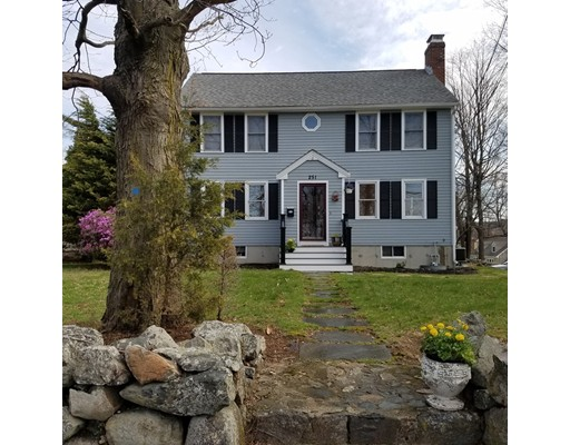 Wonderful family sized 8 room Center Entrance Colonial on the Belmont line. Back to front fireplaced living room. Formal dining room. Updated kitchen. Large family room with cathedral ceilings and access to a three seasoned porch. Three generous bedrooms and a fourth room that could be used as a bedroom, nursery or office. Hardwood floors on the first floor. Master bedroom with full bath and walk in closet. Full, 3 room in-law apartment in the basement with walk out to a patio. Garage. Large rear yard. Roof is a year old and central air conditioning system is brand new. Showings begin at Open House, Sunday,  April 15th, 12:00-2:00.