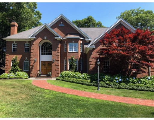 Welcome to this magnificent brick colonial built in 2002, with 5 bedrooms and 4.5 baths sited on over a half acre in Belmont Hill. The impressive foyer welcomes you with a bridal staircase, a Schonbeck chandelier, and access to the den, formal living room with a gas fireplace, and dining room with tray ceiling and Lenox light fixture. The floor plan makes for easy entertaining with the step down family room and gas fireplace which opens to the casual dining area with French doors to the backyard and a gourmet kitchen with large kitchen island, two sinks, Sub Zero refrigerator, gas cook top and wall ovens all accented with Tiffany lighting. Second staircase off family room leads to the second level with five bedrooms and two full baths, Master ensuite has a large soaking tub and separate shower, sitting area, and two closets. Finished basement has second kitchen with granite island, wood burning fireplace and bath with shower. Features include hardwood floors and central air/vacuum.