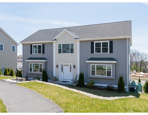 A rare opportunity to live in the Prestigious PIGEON HILL ESTATES IV overlooking the gorgeous views of the Blue Hills! This exquisite home features a stunning gourmet island granite kitchen with stainless steel appliances, granite counters, gas cooking, formal dining room with wainscoting, living room, gas fireplaced family room. The second floor features a large Master bedroom, large walk-in closet and en-suite featuring a whirlpool tub and walk-in shower. Also featuring a security system, central A/C, central vacuum, hardwood floors throughout, 2 car garage, finished walk out basement, energy star rated, high efficiency hydro-air system, irrigation system and located on a great cul-de-sac street in one of Waltham's most desirable neighborhoods!