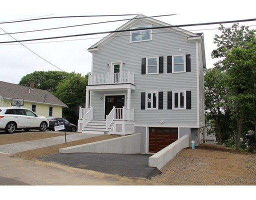 Almost finished NEW CONSTRUCTION. This large 4bd, 3 full & 2 half baths colonial in a great part of Dedham in the Oakdale school district is full of great details. Modern kitchen with stainless steel Kitchen Aid appliances, large island, custom made cabinets. From the kitchen walk out to a large 16 x 9 ft composite deck and enjoy the view and professional landscaping (soon). Natural stone countertops in the kitchen and bathrooms. Coffered ceilings and gas fireplace in the living room. Masted bedroom suite with a walk-in closet, balcony and a master bath with a double vanity, a shower and a stand-alone tub.  Large 4th bedroom and large family/entertainment room with another balcony and a full bath on the 3rd floor. Bonus/office room next to a mud room with half a bath in the finished basement leads to a 2 car tandem garage or walk out to a stone patio.  Full foam insulation, maintenance-free cement siding, maintenance-free composite porch & balconies, 3 Heat/Cool zones, 1 gas fireplace.
