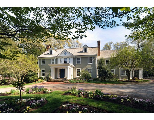 This Colonial Revival masterpiece is a testament to one of MF Reynolds' finest renovation and expansion projects. Offering a quality of construction and materials exceeding that typically found in new builds, the floor plan was designed with a principal goal – to be first and foremost a family home designed around a central core dedicated to a large open plan kitchen and a generously proportioned family room.  To the rear, a large patio overlooks lawns for children's activities and a woodland wonderland for exploration. Set upon Myopia Hill, in an estate setting of spectacular mature gardens, the property is surrounded by homes of similar architectural distinction. This family-friendly neighborhood provides ease of access to all Winchester offers: fine schools, children's activities and clubs, boat club, beach, golf course, and the community's Wright Locke Farm, to name a few. It is difficult to imagine that such privacy can be available within striking distance of Boston.