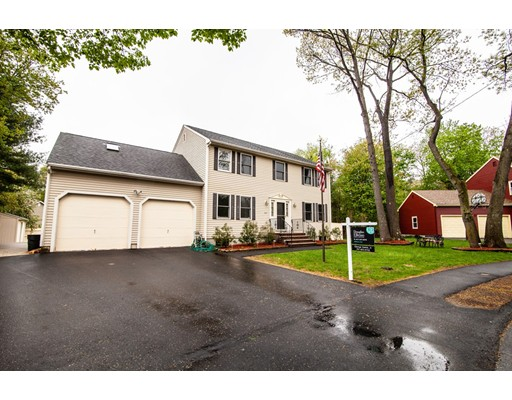 Located in the very desirable Greenlodge neighborhood, this charming up-to-date Colonial has what everyone is looking for! The open floor plan features a state-of-the-art kitchen with granite counters and stainless steel appliances, sophisticated family room with wood burning fireplace, and tons of natural light from windows & sky light! Beautifully proportioned rooms throughout. Spacious and luxurious master suite with walk-in closets, bath and study. Four additional bedrooms and two more full baths. Finished lower level offers a large recreation room, bedroom, and bath: perfect for college student, au pair, or guests. 2-car attached garage provides easy access to laundry room and kitchen. Professionally landscaped grounds with mature trees and shrubs, deck. Commuter rail, Legacy Place, Endicott library nearby. Easy access to Rte 128/95.