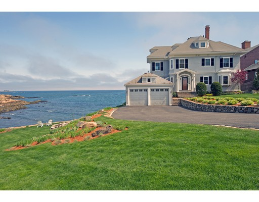 Stunning Great Gatsby waterfront home with spectacular 270 degree views of islands, Boston Light, and South Shore. Your own beach sits at the base of a gorgeous granite stone wall. A warm maple paneled foyer welcomes you home. Living and dining areas feature ornate wood fireplaces and large picture windows with outstanding views and access to a wrap-around deck. 1st floor also includes a granite/marble kitchen, half bath and cozy den with views of the ocean. 2nd level has 4 BRs and 3 full baths. Master suite offers a wood-burning fireplace, large ocean view windows and a renovated bath with heated floors. Another BR/office has picture ocean view windows, a fireplace and an ocean-facing deck. 3rd level with office space, a game room, a BR and a magical unique turret deck hanging over the ocean! Lower level has spacious in-law/au-pair apartment w/views. Exterior features: attached 2-car garage, and beach (perfect for kayakers). Located on a dead-end street with close proximity to Boston.